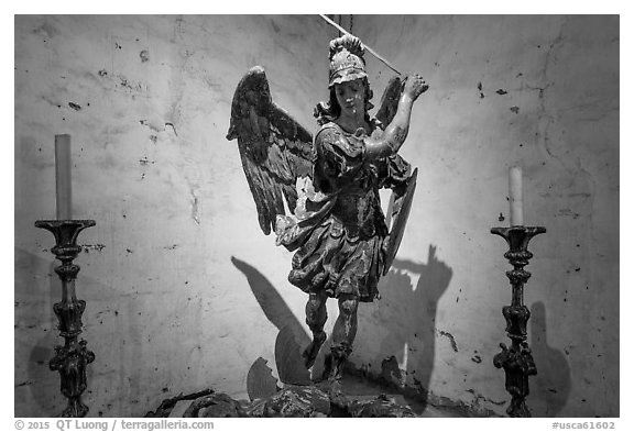 Statue of archangel San Miguel slaying dragon. California, USA (black and white)