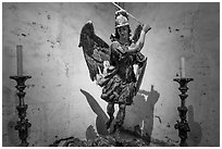 Statue of archangel San Miguel slaying dragon. California, USA ( black and white)