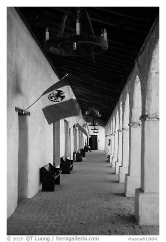 Outside arcade with Mexican and Spanish flags. California, USA (black and white)