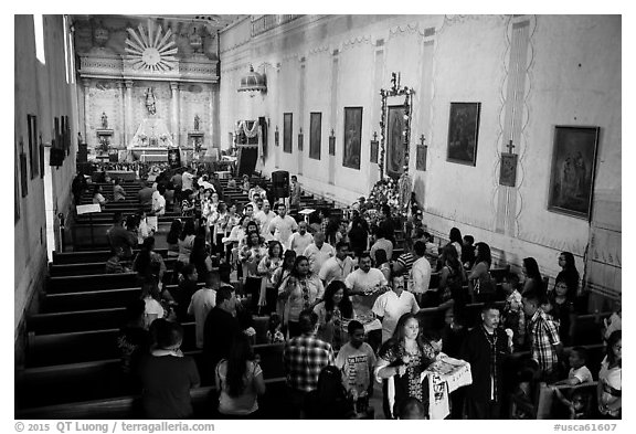 Festival procession in Mission San Miguel church. California, USA (black and white)