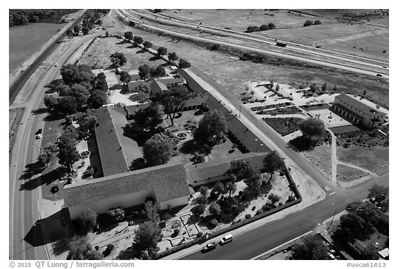 Aerial view of Mission San Miguel between railroad and highway. California, USA (black and white)