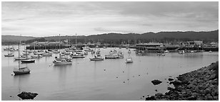 Municipal Wharf and Fishermans Wharf, late afternoon. Monterey, California, USA (Panoramic black and white)