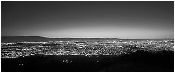 Lights of San Jose and Silicon Valley at sunset. San Jose, California, USA (Panoramic black and white)