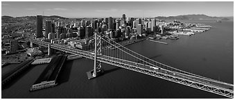 Aerial view of Bay Bridge and downtown skyline. San Francisco, California, USA (Panoramic black and white)