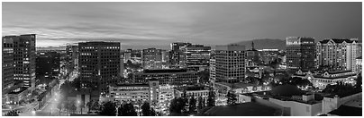 San Jose skyline at dusk from Adobe building to Fairmont hotel. San Jose, California, USA (Panoramic black and white)