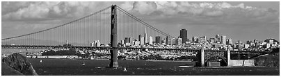 Golden Gate Bridge, and San Francisco city skyline with cloudy sky. San Francisco, California, USA (Panoramic black and white)