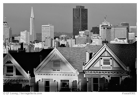 Victorians at Alamo Square and skyline, late afternoon. San Francisco, California, USA (black and white)