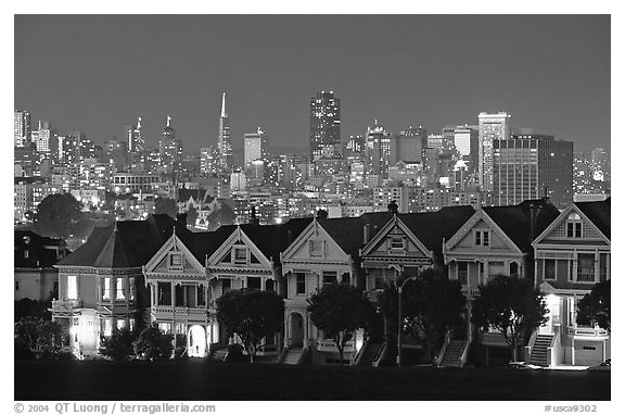Victorians at Alamo Square and skyline, night. San Francisco, California, USA (black and white)