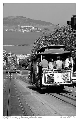 Cable car on Hyde Street, with Alcatraz Island in the background. San Francisco, California, USA (black and white)