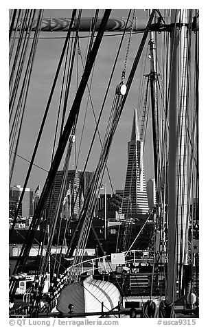 Transamerica Pyramid  seen through the masts of the Balclutha. San Francisco, California, USA (black and white)