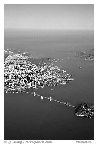 Aerial view of the Bay Bridge, the city, and  the Golden Gate Bridge. San Francisco, California, USA (black and white)