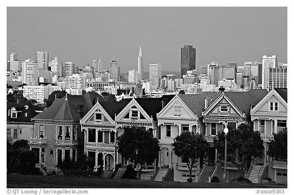 Victorians at Alamo Square and skyline, dusk. San Francisco, California, USA (black and white)