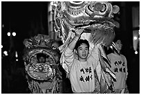 Lion dancers  during the Chinese New Year celebration. San Francisco, California, USA ( black and white)