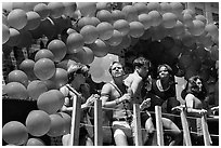 Men with rainbowed ballons on a float during the Gay Parade. San Francisco, California, USA (black and white)