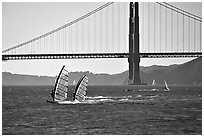 Windsurfers at Crissy Field, with the Golden Gate Bridge behind. San Francisco, California, USA (black and white)