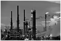 Pipes of Oil Refinery near Rodeo at dusk. SF Bay area, California, USA ( black and white)