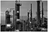 Pipes of industrial Oil Refinery near Rodeo at dusk. SF Bay area, California, USA ( black and white)