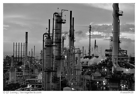 Chimneys of industrial Oil Refinery near Rodeo at dusk. SF Bay area, California, USA