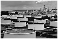 Storage citerns and piples of Oil Refinery near Rodeo. SF Bay area, California, USA ( black and white)