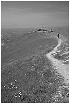 Hiker on trail at the summit of Mission Peak, Mission Peak Regional Park. California, USA ( black and white)