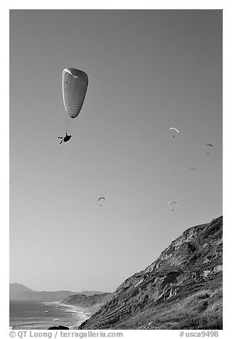 Paragliding above a sea cliff, the Dumps, Pacifica. San Mateo County, California, USA (black and white)
