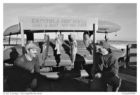 Fishermen with caught fish, Capitola. Capitola, California, USA (black and white)