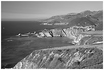 Distant view of Bixby Creek Bridge and coast, afternoon. Big Sur, California, USA (black and white)