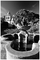 Fountain and chapel, Carmel Mission. Carmel-by-the-Sea, California, USA ( black and white)