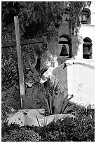 Cross, statue of father, belltower, Mission San Diego de Alcala. San Diego, California, USA ( black and white)
