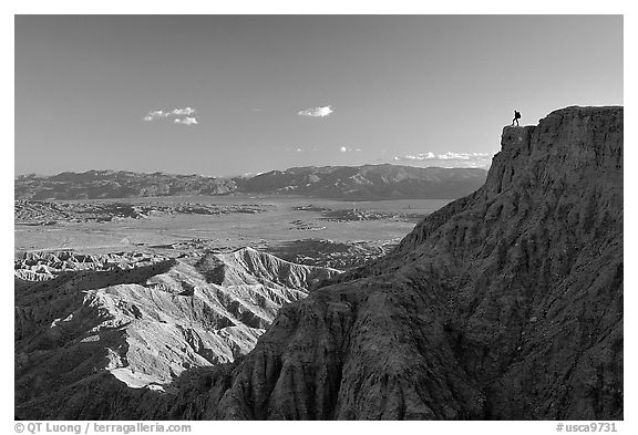Visitor surveying panorama at Font Point. Anza Borrego Desert State Park, California, USA (black and white)