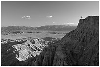 Visitor surveying panorama at Font Point. Anza Borrego Desert State Park, California, USA ( black and white)