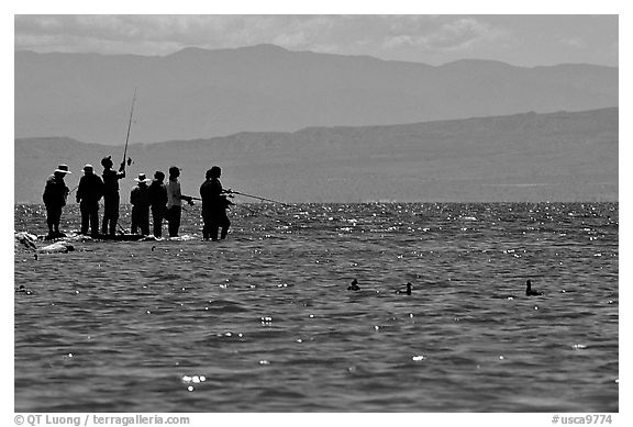 Fishermen on the shore of Salton Sea. California, USA (black and white)