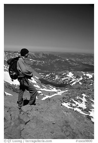 Hiker standing on top of Round Top Mountain. Mokelumne Wilderness, Eldorado National Forest, California, USA (black and white)