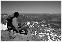 Hiker sitting  on top of Round Top Mountain. Mokelumne Wilderness, Eldorado National Forest, California, USA (black and white)