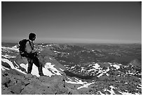 Hiker standing on top of Round Top Peak. Mokelumne Wilderness, Eldorado National Forest, California, USA ( black and white)