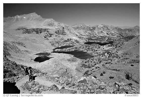 Backpacker on Bishop Pass trail, Inyo National Forest. California, USA (black and white)
