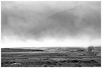 Mineral deposits of dry lake stirred up by a windstorm, Owens Valley. California, USA (black and white)
