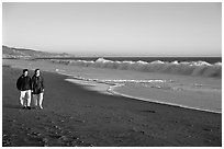Couple strolling on the beach, late afternoon. Point Reyes National Seashore, California, USA (black and white)