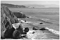 Cliffs and Point Bonita Lighthouse, late afternoon. California, USA (black and white)