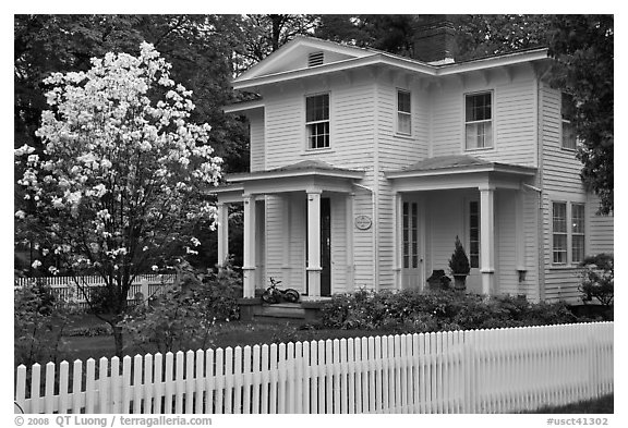 White picket fence and house, Essex. Connecticut, USA (black and white)