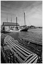 Wooden crab traps and historic ships. Mystic, Connecticut, USA (black and white)