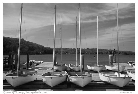 Small sailboasts parked on deck and Mystic River. Mystic, Connecticut, USA (black and white)