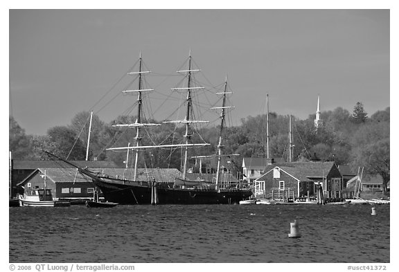 Three masted ship, Mystic River, and church. Mystic, Connecticut, USA (black and white)