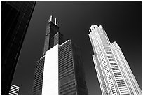Sears tower and other skyscrappers towering in the sky. Chicago, Illinois, USA (black and white)