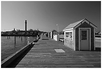 Pier and Pilgrim Monument, Provincetown. Cape Cod, Massachussets, USA (black and white)