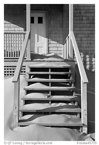Drifting sands on porch, Old Harbor life-saving station, Cape Cod National Seashore. Cape Cod, Massachussets, USA (black and white)