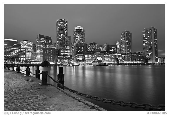 Night skyline above harbor. Boston, Massachussets, USA (black and white)