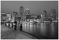 Night skyline above harbor. Boston, Massachussets, USA ( black and white)