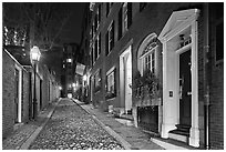 Cobblestone narrow street by night, Beacon Hill. Boston, Massachussets, USA ( black and white)