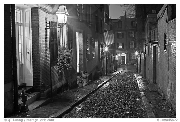 Picturesque cobblestone street on rainy night, Beacon Hill. Boston, Massachussets, USA (black and white)
